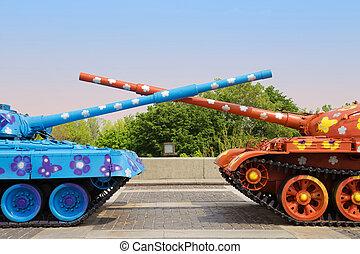 Painted tanks with crossed trunks. Kyiv, Ukraine