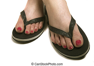 Painted Toes in Sandles - A woman with a fresh pedicure in...