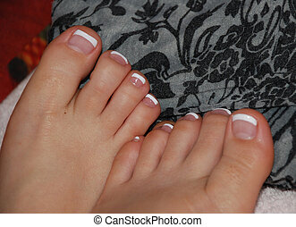 Toe nail tips painted white.