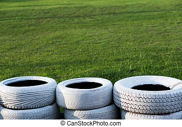 Painted white old tires on kart race course