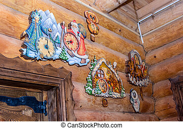 painted wooden wall clock on log wall