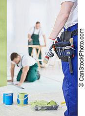Painter and carpenter at work