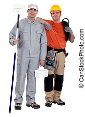 Painter and electrician standing on white background