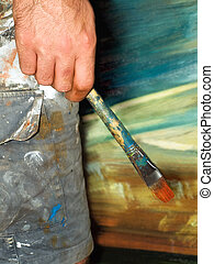 Painter - Closeup of the painter\'s creative moment of...