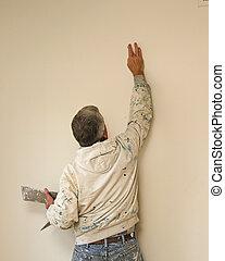 painter filling hole