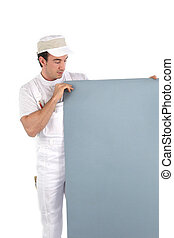 Painter holding a board