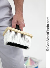 painter holding a brush