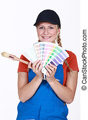 Painter holding a selection of colour samples