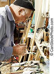 Painter holding paint tube