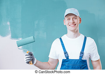 Painter holding roller