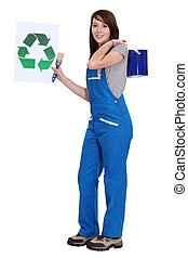 Painter holding up the recycling symbol