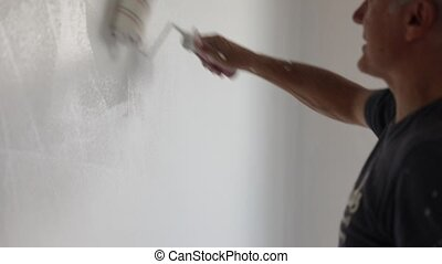 Painter in slow motion - Painter with paint roller and...