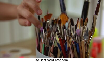 Painter is checking her instruments - Artist finds exact...