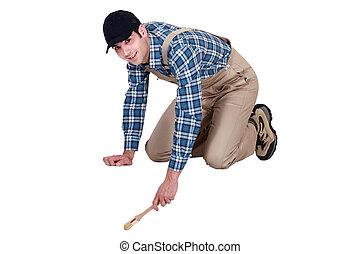 Painter kneeling