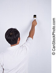 painter man at work with a Brush painting on wall