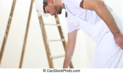 painter man at work with brush, wall painting concept, white...