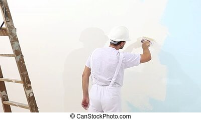 painter man at work with brush, wall painting concept, white copy space background
