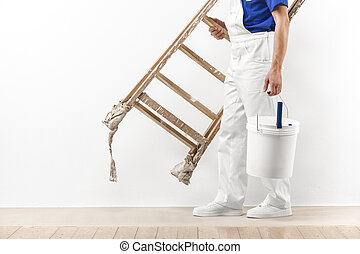 Painter man at work with vintage ladder and bucket.