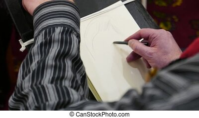 painter painting a woman's caricature portrait on paper canvas, with pencil