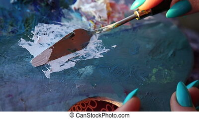 Painter palette knife moving closeup background - Concept...