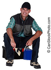 Painter sitting on a toolbox
