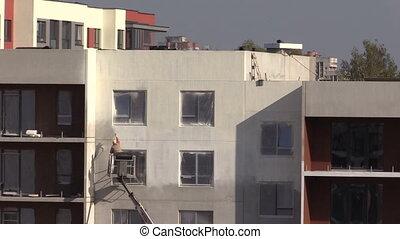 painter spray paint house