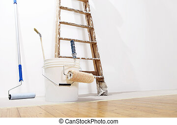 painter wall concept, ladder, bucket, roll paint on the floor