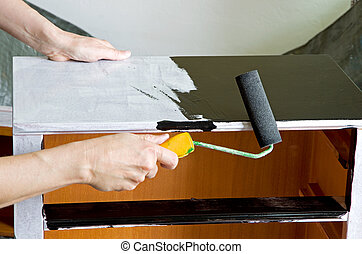 painter with paint roller