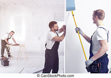 Painter with roller painting wall on blue while redecorating interior
