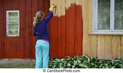painter woman brush wall