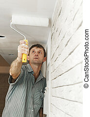 Painter worker painting a ceiling