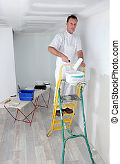 Painter working on project alone