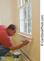 Painter working - Painter painting interior of house that is...