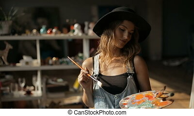 Painter Works with Palette - Happy caucasian painter works...