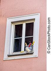 painters utensils in front of a window - art supplies in...