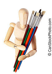 Painter's wooden model with paintbrushes