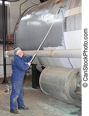 Painting a large steam boiler