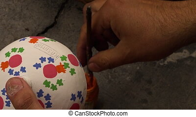 Painting a pattern on a Kasmir powder box - Top down view of...