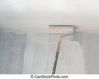 painting a wall and ceiling with roller