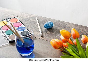 Painting Easter eggs on wooden table