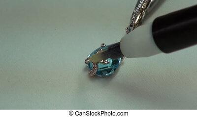 Painting gems acid in jewelry.