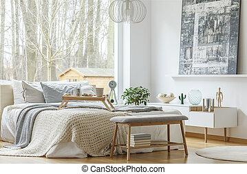 Painting in modern bedroom interior