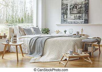 Painting in scandi bedroom interior