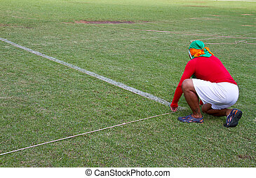 Painting lines football on the fiel