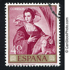 painting of St Agnes - SPAIN - CIRCA 1969: stamp printed by...