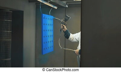 Painting process by spray gun for decoration work piece -...