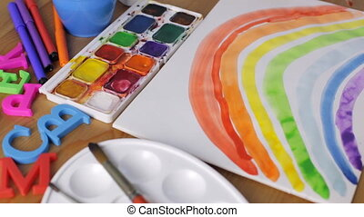 Painting rainbow with watercolors at home