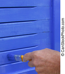 Painting Shutters - Painting wooden shutters blue with a...