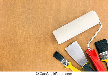 painting supplies on wooden background