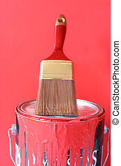 painting supplies - paintbrush on top of red paint can for ...